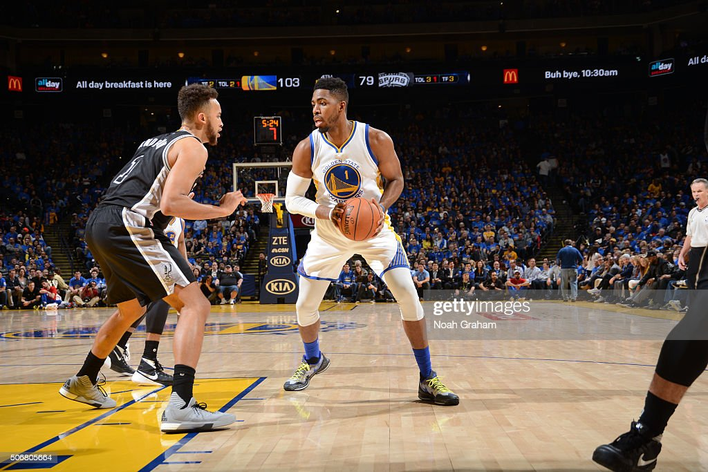 Jason Thompson #1 of the Golden State Warriors drives against Kyle Anderson #1 of the San Antonio Spurs on January 25, 2016 at Oracle Arena in Oakland, California.
