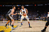 Jason Thompson of the Golden State Warriors drives against Kyle Anderson of the San Antonio Spurs on January 25 2016 at Oracle Arena in Oakland...