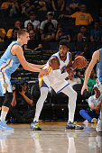 Jason Thompson of the Golden State Warriors handles the ball against the Denver Nuggets during a preseason game on October 13 2015 at ORACLE Arena in...