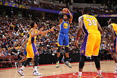 Jason Thompson of the Golden State Warriors shoots against the Los Angeles Lakers during a preseason game on October 22 2015 at Honda Center in...