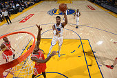 Jason Thompson of the Golden State Warriors shoots against the Houston Rockets on October 15 2015 at Oracle Arena in Oakland California NOTE TO USER...
