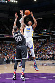 Jason Thompson of the Golden State Warriors shoots against Willie CauleyStein of the Sacramento Kings on November 7 2015 at Sleep Train Arena in...
