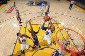Jason Thompson of the Golden State Warriors shoots the ball against the Sacramento Kings on December 28 2015 at ORACLE Arena in Oakland California...