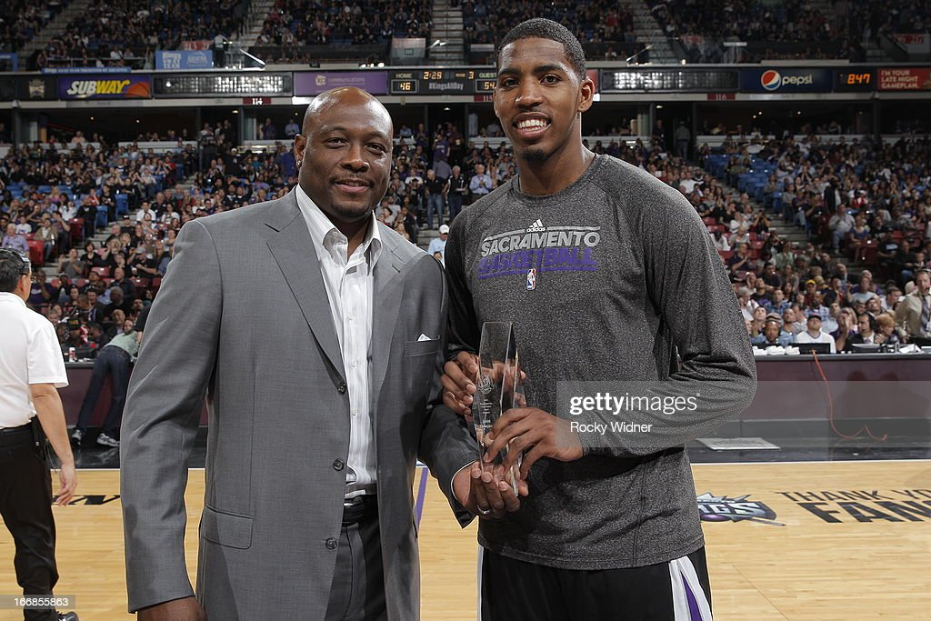 Jason Thompson #34 of the Sacramento Kings accepts the Oscar Robertson Triple Double Award from Mitch Richmond during halftime against the Los Angeles Clippers on April 17, 2013 at Sleep Train Arena in Sacramento, California.