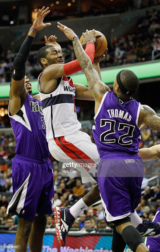 Jason Thompson #34 of the Sacramento Kings (L) and teammate Isaiah Thomas #22 defend against <a gi-track='captionPersonalityLinkClicked' href=/galleries/search?phrase=John+Wall&family=editorial&specificpeople=2265812 ng-click='$event.stopPropagation()'>John Wall</a> #2 of the Washington Wizards during the second half at Verizon Center on February 22, 2012 in Washington, DC.