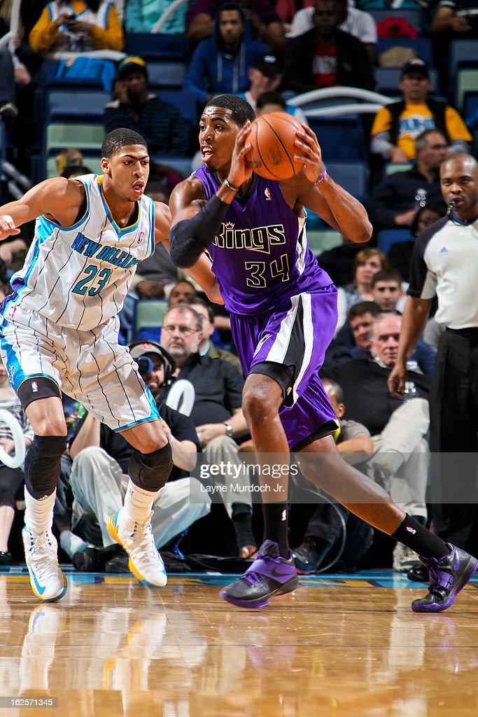 Jason Thompson #34 of the Sacramento Kings controls the ball against Anthony Davis #23 of the New Orleans Hornets on February 24, 2013 at the New Orleans Arena in New Orleans, Louisiana.