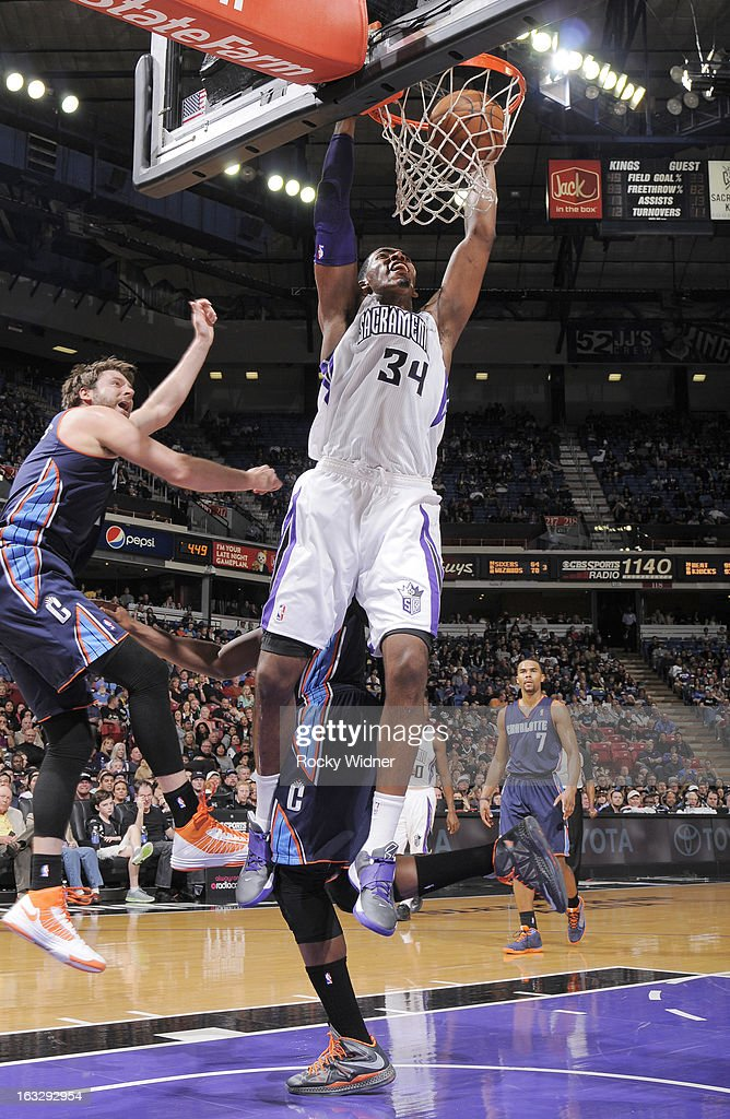 Jason Thompson #34 of the Sacramento Kings dunks against <a gi-track='captionPersonalityLinkClicked' href=/galleries/search?phrase=Josh+McRoberts&family=editorial&specificpeople=732530 ng-click='$event.stopPropagation()'>Josh McRoberts</a> #11 of the Charlotte Bobcats on March 3, 2013 at Sleep Train Arena in Sacramento, California.