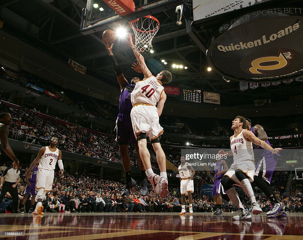 Jason Thompson #34 of the Sacramento Kings goes up for the shot against Tyler Zeller #40 of the Cleveland Cavaliers at The Quicken Loans Arena on January 2, 2013 in Cleveland, Ohio.