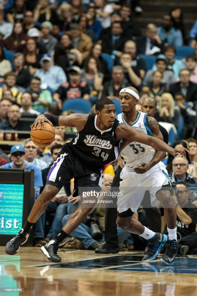 Jason Thompson #34 of the Sacramento Kings handles the ball against <a gi-track='captionPersonalityLinkClicked' href=/galleries/search?phrase=Dante+Cunningham&family=editorial&specificpeople=683729 ng-click='$event.stopPropagation()'>Dante Cunningham</a> #33 of the Minnesota Timberwolves during the season opening game on November 2, 2012 at Target Center in Minneapolis, Minnesota.