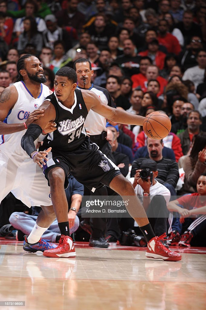 Jason Thompson #34 of the Sacramento Kings protects the ball from Ronny Turiaf #21 of the Los Angeles Clippers during the game between the Los Angeles Clippers and the Sacramento Kings at Staples Center on December 1, 2012 in Los Angeles, California.