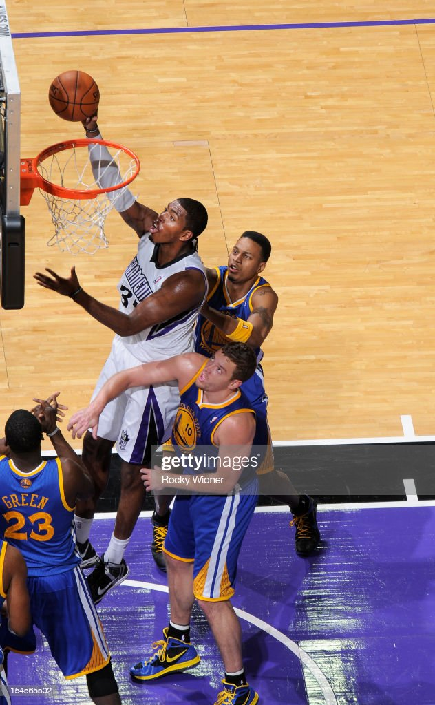 Jason Thompson #34 of the Sacramento Kings puts up a shot against David Lee #10 and <a gi-track='captionPersonalityLinkClicked' href=/galleries/search?phrase=Brandon+Rush+-+Basketball+Player&family=editorial&specificpeople=802089 ng-click='$event.stopPropagation()'>Brandon Rush</a> #4 of the Golden State Warriors on October 17, 2012 at Power Balance Pavilion in Sacramento, California.