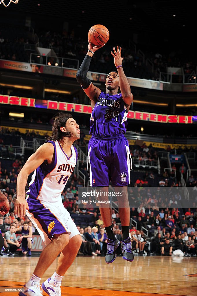 Jason Thompson #34 of the Sacramento Kings puts up a shot over <a gi-track='captionPersonalityLinkClicked' href=/galleries/search?phrase=Luis+Scola&family=editorial&specificpeople=2464749 ng-click='$event.stopPropagation()'>Luis Scola</a> #14 of the Phoenix Suns on December 17, 2012 at U.S. Airways Center in Phoenix, Arizona.