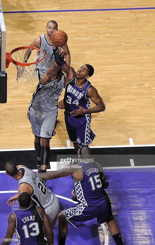 Jason Thompson #34 of the Sacramento Kings rebounds against Boris Diaw #33 of the San Antonio Spurs on February 19, 2013 at Sleep Train Arena in Sacramento, California.