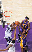 Jason Thompson of the Sacramento Kings rebounds against Ed Davis of the Los Angeles Lakers on December 21 2014 at Sleep Train Arena in Sacramento...