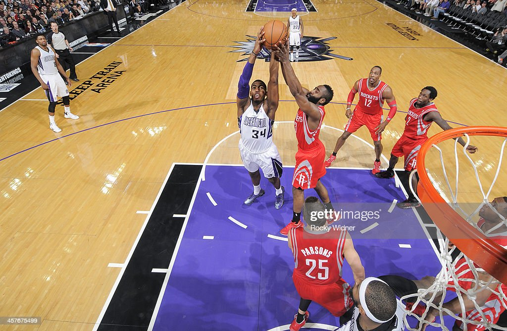 Jason Thompson #34 of the Sacramento Kings rebounds against <a gi-track='captionPersonalityLinkClicked' href=/galleries/search?phrase=James+Harden&family=editorial&specificpeople=4215938 ng-click='$event.stopPropagation()'>James Harden</a> #13 of the Houston Rockets on December 15, 2013 at Sleep Train Arena in Sacramento, California.
