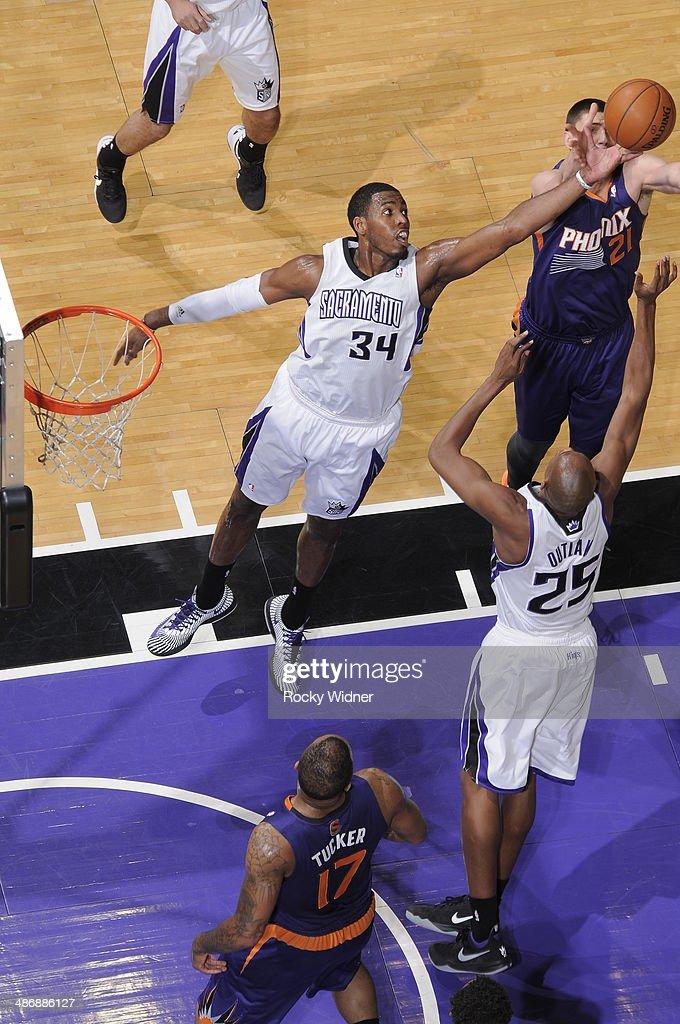 Jason Thompson #34 of the Sacramento Kings rebounds against the Phoenix Suns on April16, 2014 at Sleep Train Arena in Sacramento, California.