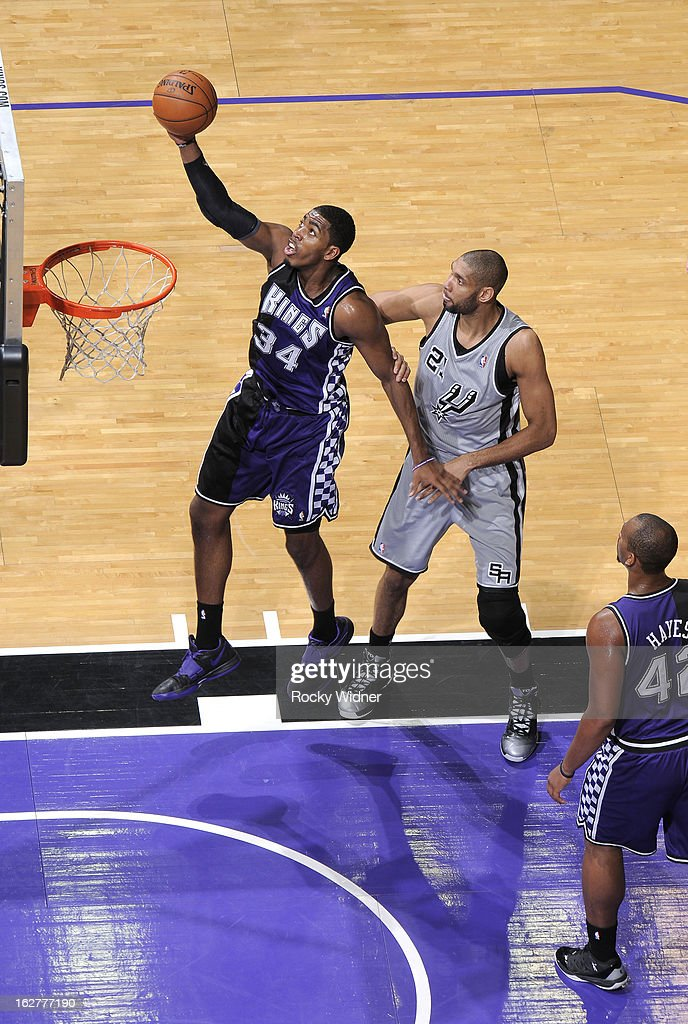 Jason Thompson #34 of the Sacramento Kings rebounds against <a gi-track='captionPersonalityLinkClicked' href=/galleries/search?phrase=Tim+Duncan&family=editorial&specificpeople=201467 ng-click='$event.stopPropagation()'>Tim Duncan</a> #21 of the San Antonio Spurs on February 19, 2013 at Sleep Train Arena in Sacramento, California.