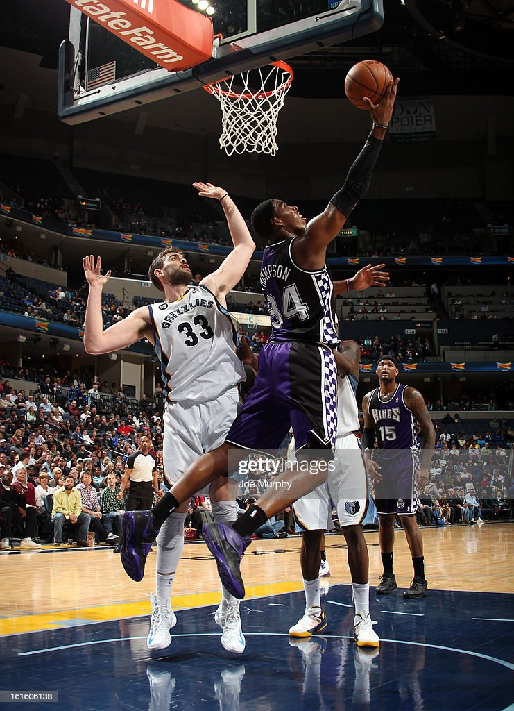 Jason Thompson #34 of the Sacramento Kings shoots a reverse layup against Marc Gasol #33 of the Memphis Grizzlies on February 12, 2013 at FedExForum in Memphis, Tennessee.