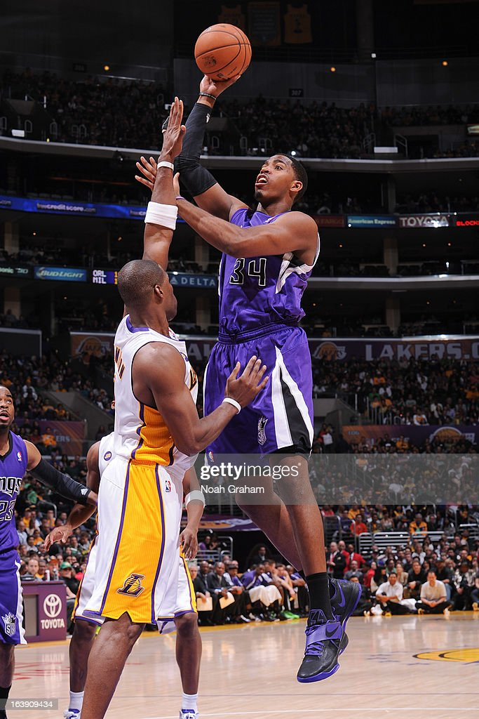 Jason Thompson #34 of the Sacramento Kings shoots against <a gi-track='captionPersonalityLinkClicked' href=/galleries/search?phrase=Antawn+Jamison&family=editorial&specificpeople=201670 ng-click='$event.stopPropagation()'>Antawn Jamison</a> #4 of the Los Angeles Lakers at Staples Center on March 17, 2013 in Los Angeles, California.