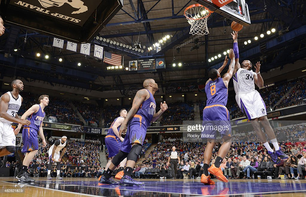 Jason Thompson #34 of the Sacramento Kings shoots against <a gi-track='captionPersonalityLinkClicked' href=/galleries/search?phrase=Channing+Frye&family=editorial&specificpeople=206815 ng-click='$event.stopPropagation()'>Channing Frye</a> #8 of the Phoenix Suns on November 19, 2013 at Sleep Train Arena in Sacramento, California.