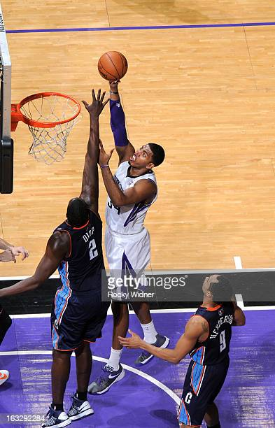 Jason Thompson of the Sacramento Kings shoots against DeSagana Diop of the Charlotte Bobcats on March 3 2013 at Sleep Train Arena in Sacramento...