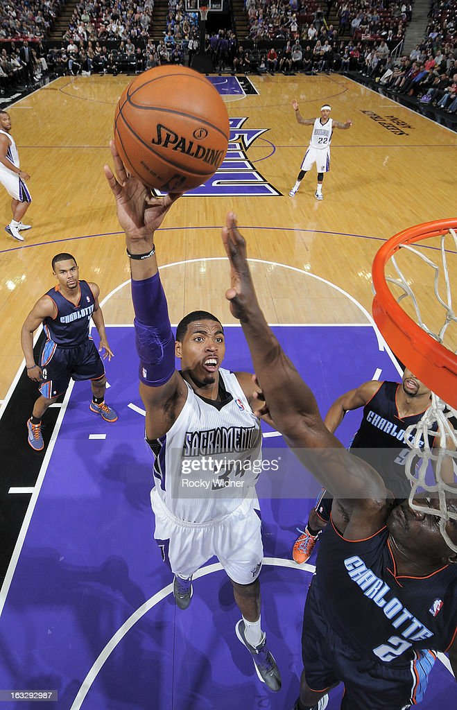Jason Thompson #34 of the Sacramento Kings shoots against <a gi-track='captionPersonalityLinkClicked' href=/galleries/search?phrase=DeSagana+Diop&family=editorial&specificpeople=213233 ng-click='$event.stopPropagation()'>DeSagana Diop</a> #2 of the Charlotte Bobcats on March 3, 2013 at Sleep Train Arena in Sacramento, California.