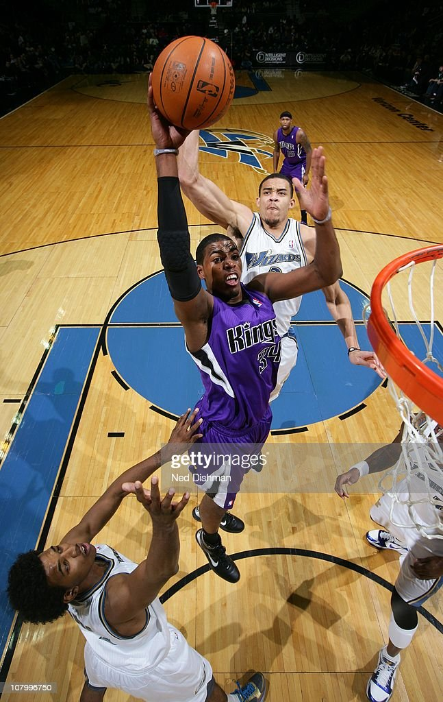 Jason Thompson of the Sacramento Kings shoots against JaVale McGee and Nick Young of the Washington Wizards at the Verizon Center on January 11 2011...
