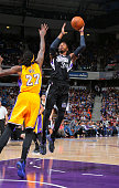 Jason Thompson of the Sacramento Kings shoots against Jordan Hill of the Los Angeles Lakers on April 13 2015 at Sleep Train Arena in Sacramento...