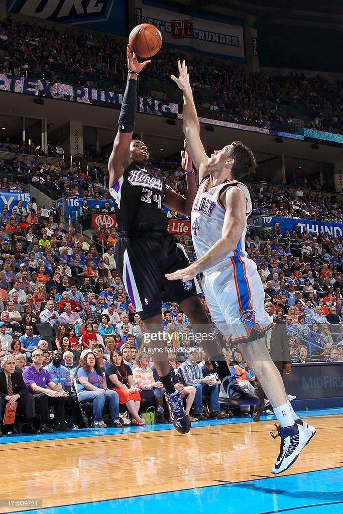 Jason Thompson #34 of the Sacramento Kings shoots against <a gi-track='captionPersonalityLinkClicked' href=/galleries/search?phrase=Nick+Collison&family=editorial&specificpeople=202843 ng-click='$event.stopPropagation()'>Nick Collison</a> #4 of the Oklahoma City Thunder on April 15, 2013 at the Chesapeake Energy Arena in Oklahoma City, Oklahoma.