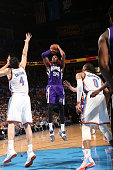 Jason Thompson of the Sacramento Kings shoots against Nick Collison of the Oklahoma City Thunder on April 10 2015 at the Chesapeake Energy Arena in...