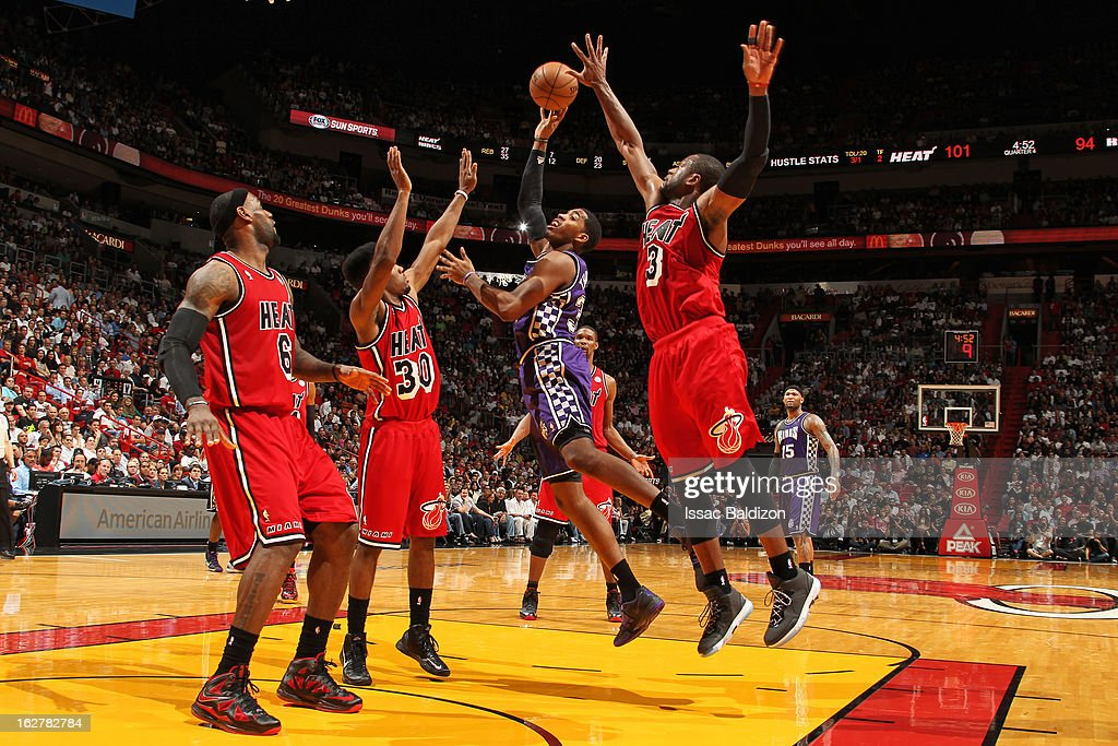 Jason Thompson #34 of the Sacramento Kings shoots against <a gi-track='captionPersonalityLinkClicked' href=/galleries/search?phrase=Norris+Cole&family=editorial&specificpeople=5770147 ng-click='$event.stopPropagation()'>Norris Cole</a> #30 and <a gi-track='captionPersonalityLinkClicked' href=/galleries/search?phrase=Dwyane+Wade&family=editorial&specificpeople=201481 ng-click='$event.stopPropagation()'>Dwyane Wade</a> #3 of the Miami Heat on February 26, 2013 at American Airlines Arena in Miami, Florida.