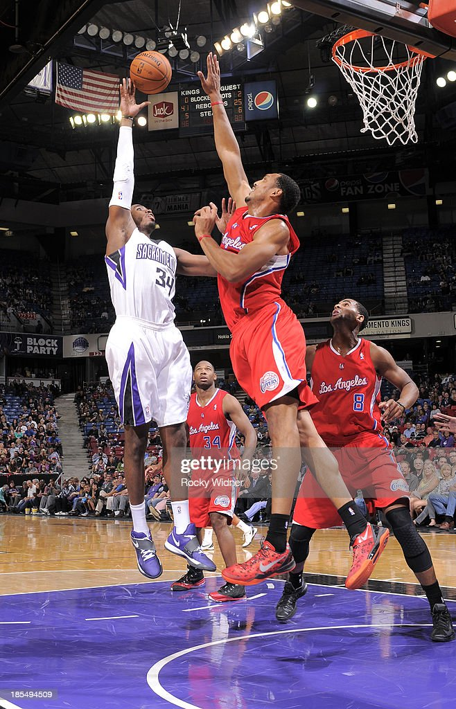 Jason Thompson #34 of the Sacramento Kings shoots against <a gi-track='captionPersonalityLinkClicked' href=/galleries/search?phrase=Ryan+Hollins&family=editorial&specificpeople=182556 ng-click='$event.stopPropagation()'>Ryan Hollins</a> #15 of the Los Angeles Clippers on October 14, 2013 at Sleep Train Arena in Sacramento, California.