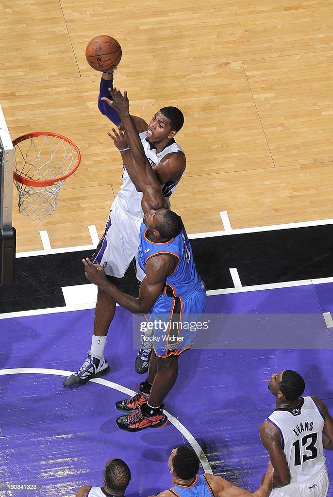 Jason Thompson #34 of the Sacramento Kings shoots against Serge Ibaka #9 of the Oklahoma City Thunder on January 25, 2013 at Sleep Train Arena in Sacramento, California.