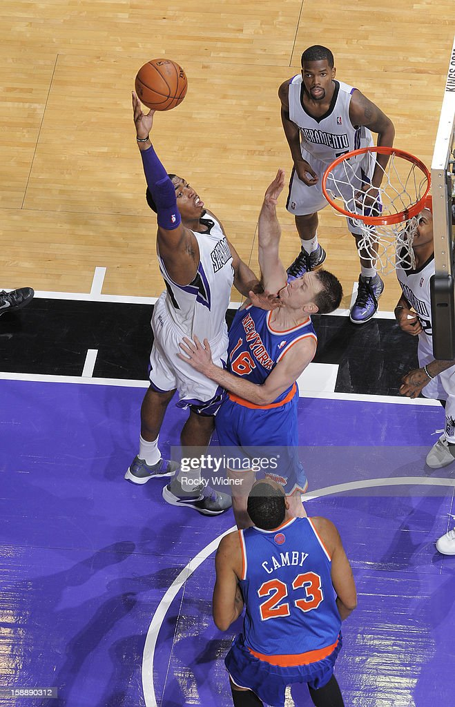 Jason Thompson #34 of the Sacramento Kings shoots against <a gi-track='captionPersonalityLinkClicked' href=/galleries/search?phrase=Steve+Novak&family=editorial&specificpeople=693015 ng-click='$event.stopPropagation()'>Steve Novak</a> #16 of the New York Knicks on December 28, 2012 at Sleep Train Arena in Sacramento, California.