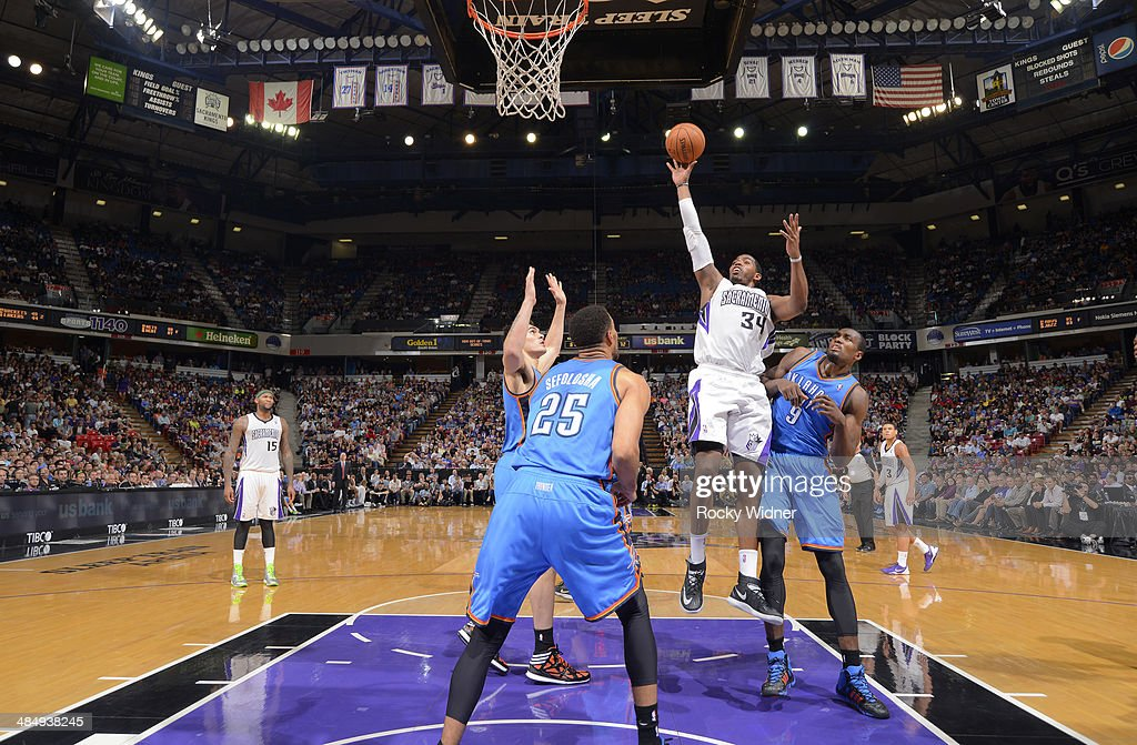 Jason Thompson #34 of the Sacramento Kings shoots against the Oklahoma City Thunder on April 8, 2014 at Sleep Train Arena in Sacramento, California.