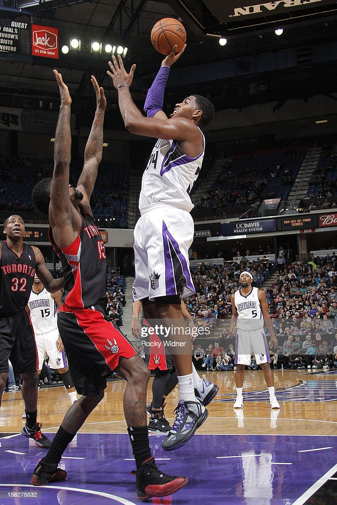 Jason Thompson #34 of the Sacramento Kings shoots over <a gi-track='captionPersonalityLinkClicked' href=/galleries/search?phrase=Amir+Johnson&family=editorial&specificpeople=556786 ng-click='$event.stopPropagation()'>Amir Johnson</a> #15 of the Toronto Raptors on December 5, 2012 at Sleep Train Arena in Sacramento, California.