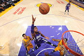 Jason Thompson of the Sacramento Kings takes a shot against the Los Angeles Lakers on April 15 2015 at STAPLES Center in Los Angeles California NOTE...