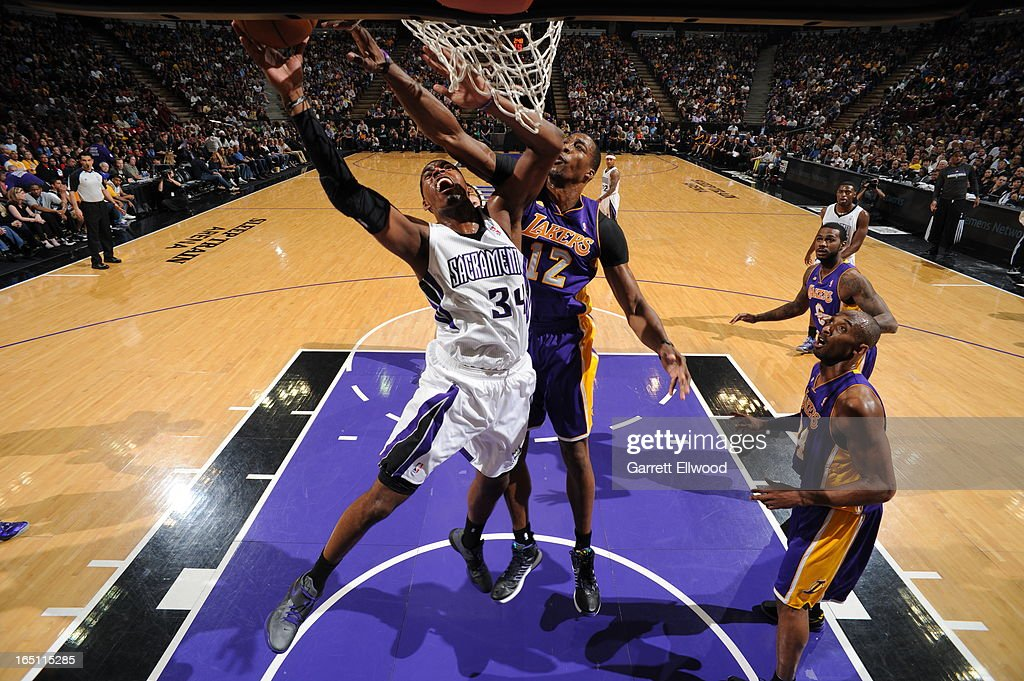 Jason Thompson #34 of the Sacramento Kings takes the ball to the basket against Dwight Howard #12 of the Los Angeles Lakers on March 30, 2013 at Sleep Train Arena in Sacramento, California.