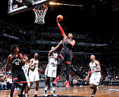 Jason Thompson of the Toronto Raptors drives to the basket against the Brooklyn Nets on April 13 2016 at Barclays Center in Brooklyn New York NOTE TO...