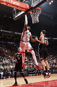 Jason Thompson of the Toronto Raptors goes up for a dunk against the Brooklyn Nets on March 8 2016 at the Air Canada Centre in Toronto Ontario Canada...