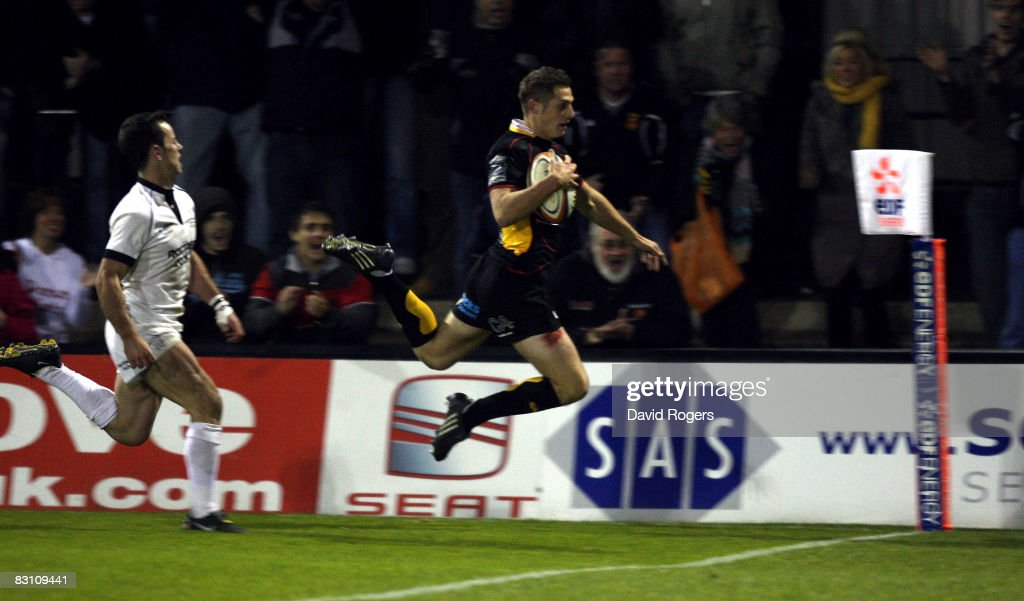 Jason Tovey of Dragons dives to score a try during the EDF Energy Cup match between Newport Gwent Dragons and Newcastle Falcons at Rodney Parade on...