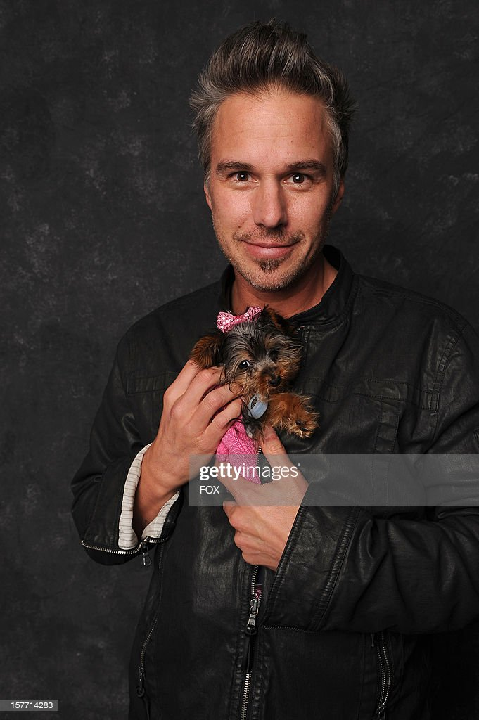Jason Trawick poses with his and Britney Spears' puppy, 'Hannah Spears', at FOX's 'The X Factor' Season 2 Top 6 Live Performance Show on December 5, 2012 in Hollywood, California.