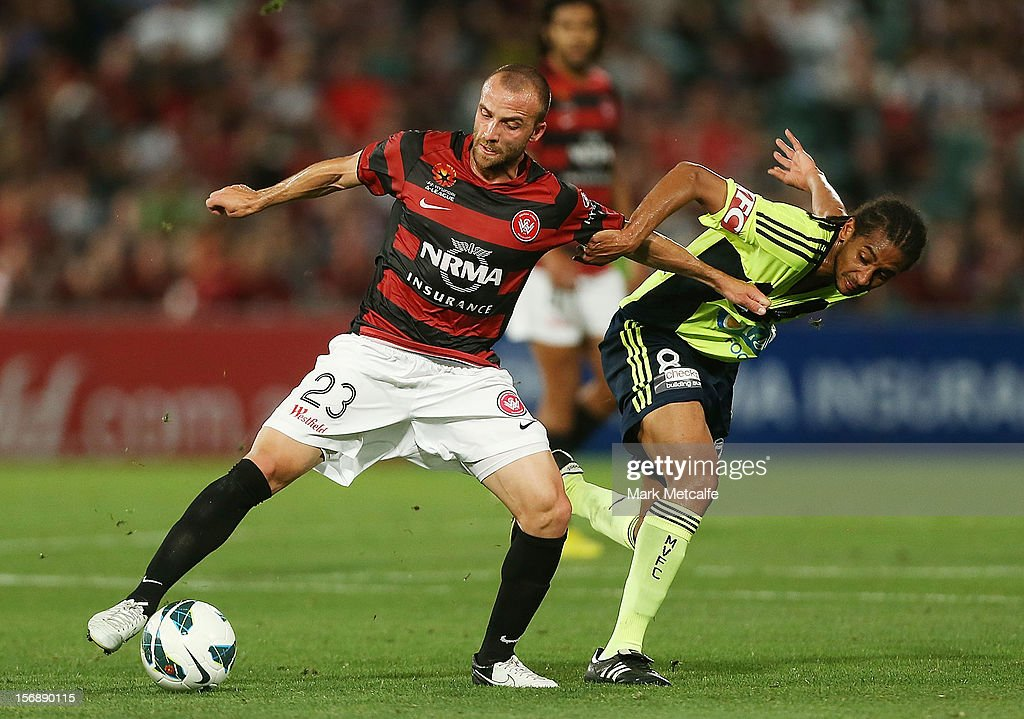 Jason Trifiro of the Wanderers is challenged by Jonathan Bru of the Victory during the round eight A-League match between the Western Sydney Wanderers and the Melbourne Victory at Parramatta Stadium on November 24, 2012 in Sydney, Australia.