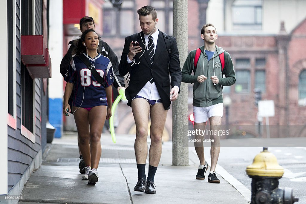 Jason Triplett, front, Jen Kent, left, Ryan Norton, left back, and Matthew Masters, right, walk to Kings bowling alley after participating in the no pants subway ride. Boston's sixth annual No Pants Subway Ride takes place in Boston, Mass. on Sunday, Jan. 13, 2013.