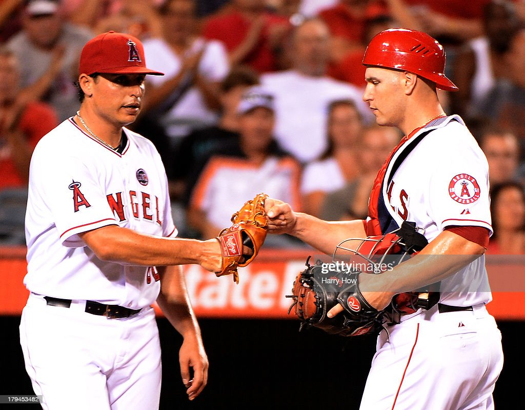 <a gi-track='captionPersonalityLinkClicked' href=/galleries/search?phrase=Jason+Vargas&family=editorial&specificpeople=640899 ng-click='$event.stopPropagation()'>Jason Vargas</a> #60 celebrates a double play with <a gi-track='captionPersonalityLinkClicked' href=/galleries/search?phrase=Chris+Iannetta&family=editorial&specificpeople=836137 ng-click='$event.stopPropagation()'>Chris Iannetta</a> #17 during the third inning against the Tampa Bay Rays at Angel Stadium of Anaheim on September 3, 2013 in Anaheim, California.