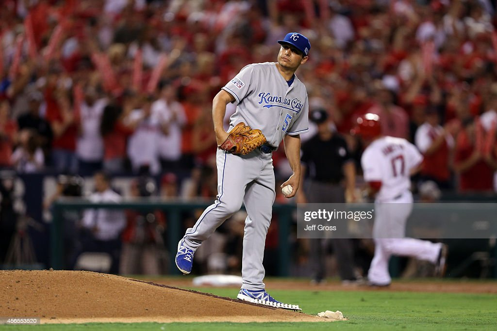 <a gi-track='captionPersonalityLinkClicked' href=/galleries/search?phrase=Jason+Vargas&family=editorial&specificpeople=640899 ng-click='$event.stopPropagation()'>Jason Vargas</a> #51 of the Kansas City Royals reacts after allowing a solo home run to <a gi-track='captionPersonalityLinkClicked' href=/galleries/search?phrase=Chris+Iannetta&family=editorial&specificpeople=836137 ng-click='$event.stopPropagation()'>Chris Iannetta</a> #17 of the Los Angeles Angels in the third inning during Game One of the American League Division Series at Angel Stadium of Anaheim on October 2, 2014 in Anaheim, California.