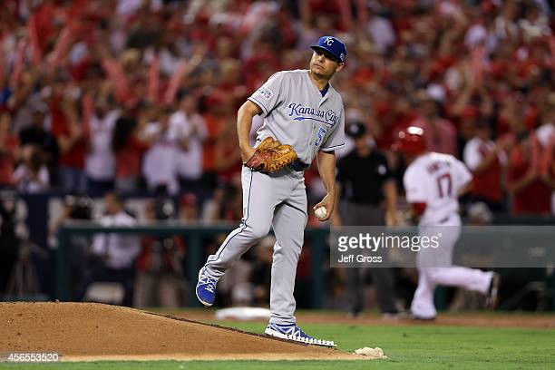 Jason Vargas of the Kansas City Royals reacts after allowing a solo home run to Chris Iannetta of the Los Angeles Angels in the third inning during...