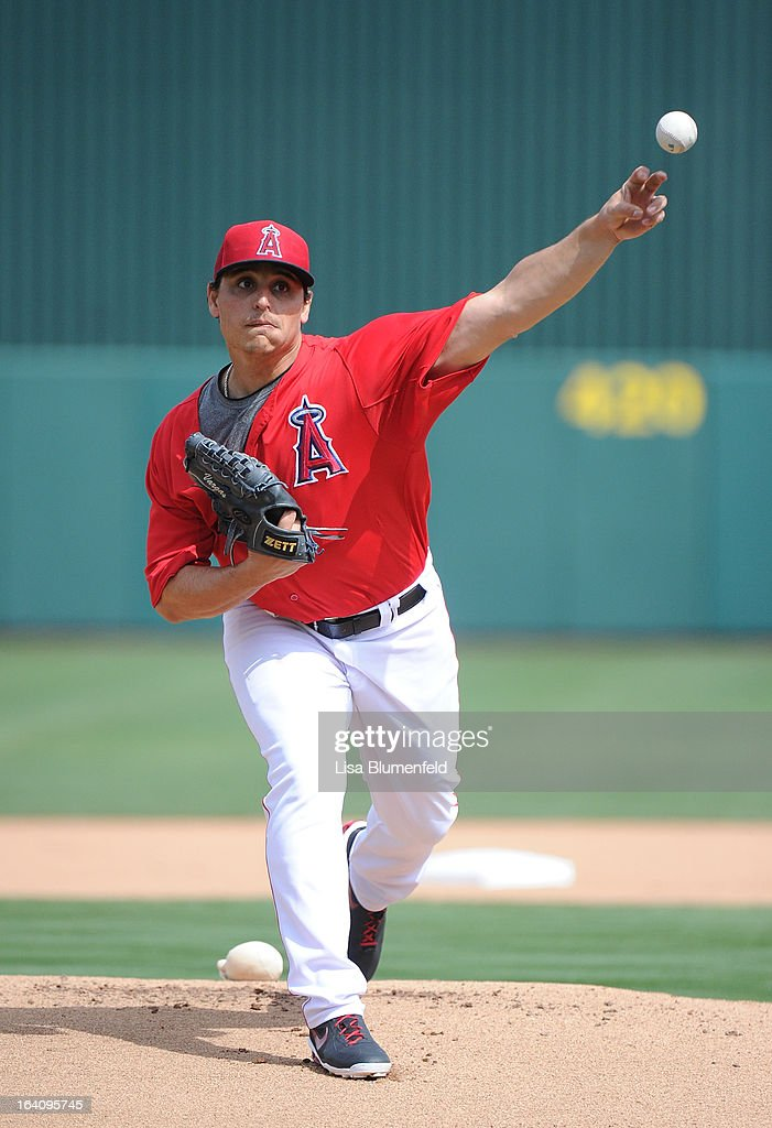 <a gi-track='captionPersonalityLinkClicked' href=/galleries/search?phrase=Jason+Vargas&family=editorial&specificpeople=640899 ng-click='$event.stopPropagation()'>Jason Vargas</a> #60 of the Los Angeles Angels of Anaheim pitches against the Colorado Rockies at Tempe Diablo Stadium on March 9, 2013 in Peoria, Arizona.