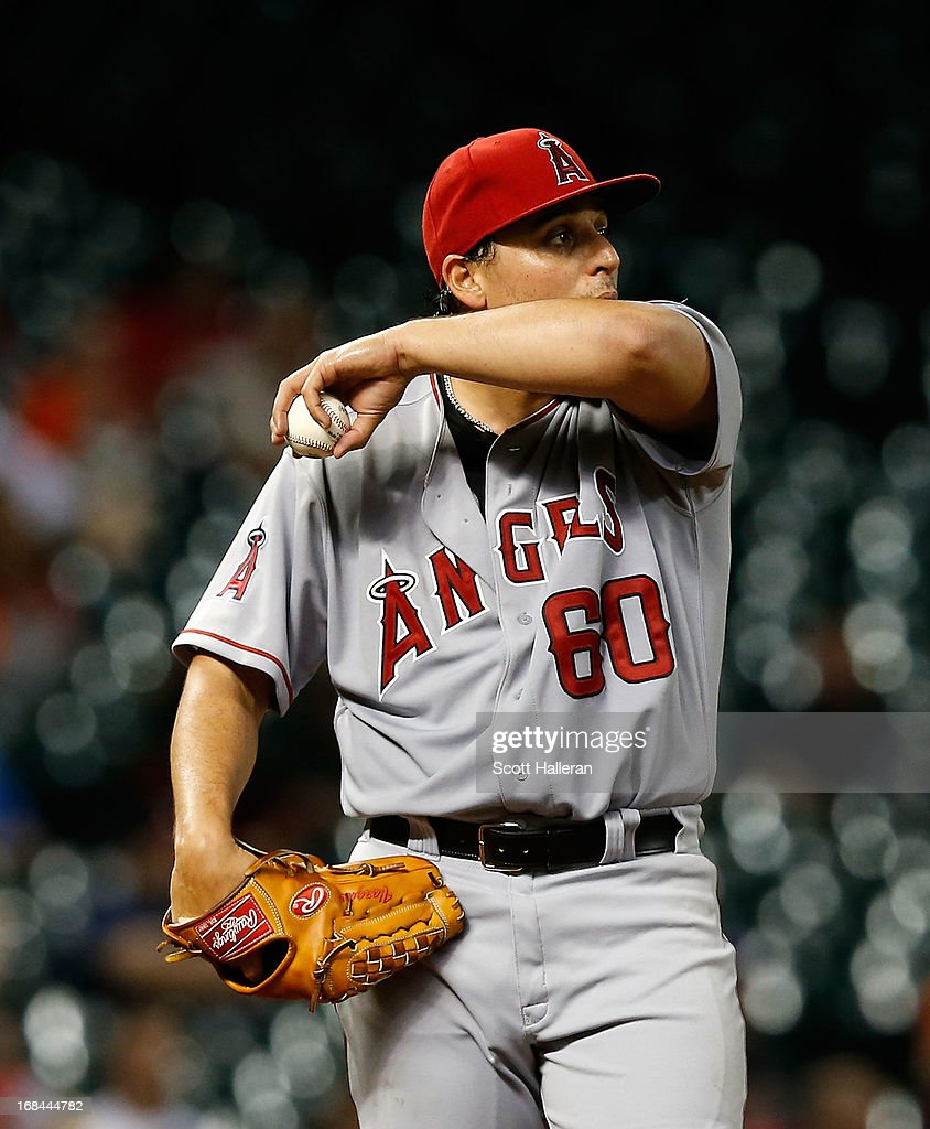 <a gi-track='captionPersonalityLinkClicked' href=/galleries/search?phrase=Jason+Vargas&family=editorial&specificpeople=640899 ng-click='$event.stopPropagation()'>Jason Vargas</a> #60 of the Los Angeles Angels of Anaheim reacts to giving up a walk during the sixth inning against the Houston Astros at Minute Maid Park on May 9, 2013 in Houston, Texas.