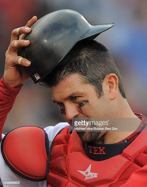 Jason Varitek of the Boston Red Sox adjusts his helmut while heading off the field against the New York Yankees in the ninth inning on October 3 2010...